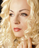 Pretty girl with curly hair Royalty Free Stock Image