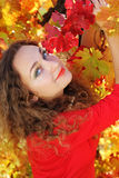 Pretty Girl with curly shiny hair in yellow grape Royalty Free Stock Photography