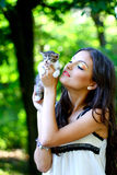 Pretty girl with cute little kitten Stock Photo