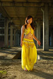Pretty girl dancing. In yellow indian dress stock photography