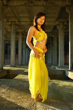 Pretty girl dancing. In yellow indian dress Stock Image