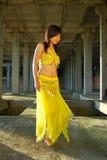 Pretty girl dancing. In yellow indian dress stock photos