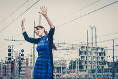 Pretty girl dancing along the tracks Stock Image