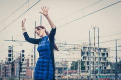 Pretty girl dancing along the tracks Stock Image