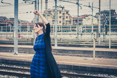 Pretty girl dancing along the tracks Royalty Free Stock Photos