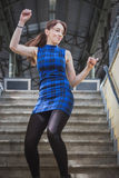 Pretty girl dancing in railroad station underpass Stock Photo
