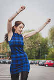Pretty girl dancing in the street Stock Photography