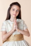 Pretty girl on the day of their communion Royalty Free Stock Photography