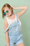 Pretty girl in denim overalls Stock Photos