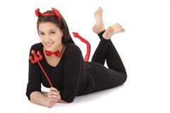 Pretty girl in devil costume smiling Royalty Free Stock Photo