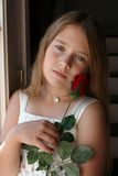 Pretty girl with diamond necklace and red rose Royalty Free Stock Images
