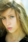 Pretty girl with dishevelled hair Royalty Free Stock Photography