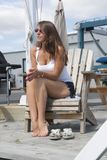 Pretty Girl on Dockside Chair at Mystic Marina stock photo