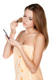 Pretty girl does makeup Stock Photo