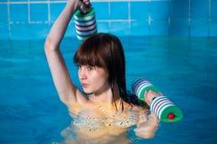 Pretty girl doing aqua aerobic exercise stock photography