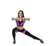 Pretty girl doing fitness exercise with dumbbells Royalty Free Stock Images