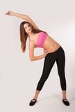 Pretty girl doing fitness exercise Stock Photography