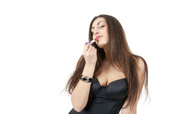 Pretty girl doing makeup with red lipstick Royalty Free Stock Photo