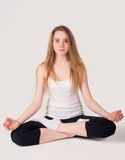 Pretty girl doing meditation exercise Stock Images