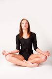 Pretty girl doing meditation exercise Stock Photos