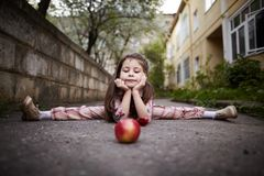 Pretty girl doing splits outdoors. Cute little pretty girl doing splits outdoors Stock Image
