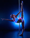 Pretty girl doing stretching exercising near pylon Royalty Free Stock Image