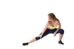 Pretty girl doing stretching, isolated on white Stock Photo