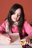 Pretty girl drawing Royalty Free Stock Photo