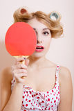 Pretty girl in dress and big curlers holding Royalty Free Stock Photo