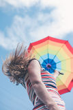 Pretty girl in dress holding rainbow umbrella on Royalty Free Stock Photos