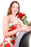 Pretty girl in dress with rose. Royalty Free Stock Images