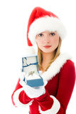 Pretty girl dressed as Santa with the keys. Pretty girl dressed as Santa giving us the keys as a present Stock Photography