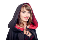 Pretty girl dressed in a black cape for halloween Stock Images