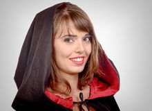 Pretty girl dressed in a black cape for halloween Royalty Free Stock Image