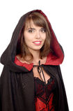 Pretty girl dressed in a black cape for halloween Royalty Free Stock Photos