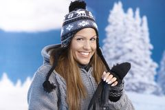 Pretty girl dressed sporty for skiing smiling Royalty Free Stock Photos