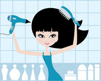 Pretty girl dries hair Royalty Free Stock Images