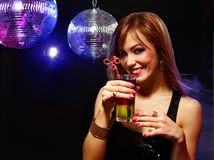 Pretty girl with a drink Stock Images