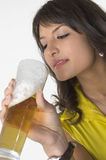 Pretty girl drinking beer from the glass. Pretty girl in yellow drinking beer from the glass Stock Photos