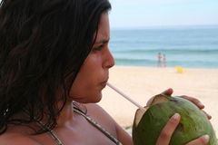 Pretty Girl drinking coconut Royalty Free Stock Photo