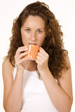 Pretty girl drinking coffee. Beautiful office girl drinking coffee, tired expression Stock Photography