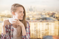 Pretty girl drinking coffee Royalty Free Stock Photography