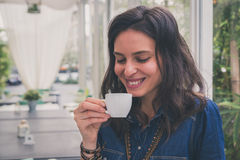 Pretty girl drinking a cup of coffee. Pretty girl with long hair drinking a cup of coffee Royalty Free Stock Images