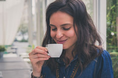 Pretty girl drinking a cup of coffee Stock Image