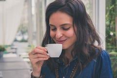Pretty girl drinking a cup of coffee. Pretty girl with long hair drinking a cup of coffee Stock Image