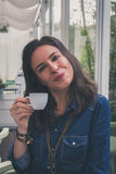 Pretty girl drinking a cup of coffee Stock Photos