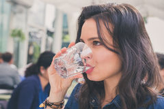 Pretty girl drinking a glass of water Royalty Free Stock Photos