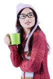 Pretty girl drinking hot tea in studio Royalty Free Stock Photos