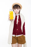 Pretty girl drinking juice Stock Image