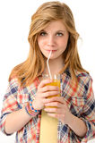 Pretty girl drinking juice with straw. Isolated on white background Stock Image